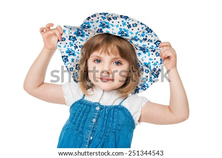 Portrait of a little girl in a blue hat - stock photo