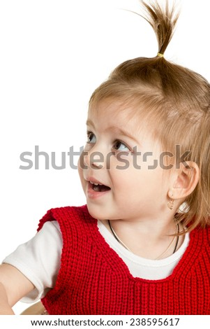 Portrait of a little girl in a knitted sweater with open mouth gazing side isolated on white background - stock photo