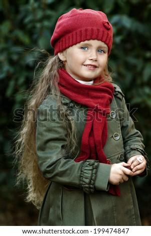 portrait of a little girl in autumn coat - stock photo