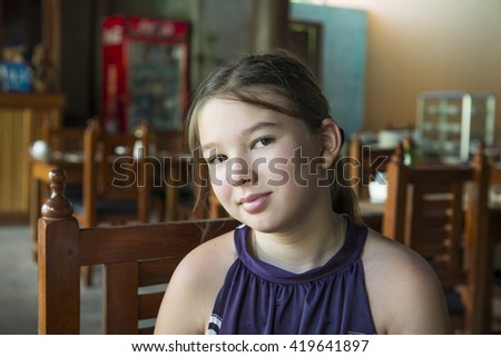 Portrait of a little girl in cafe - stock photo