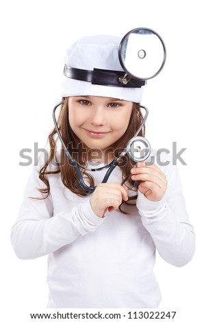 Portrait of a little girl in doctor uniform looking at camera, isolated on white - stock photo