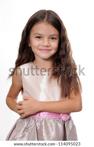 portrait of a little girl in the studio - stock photo
