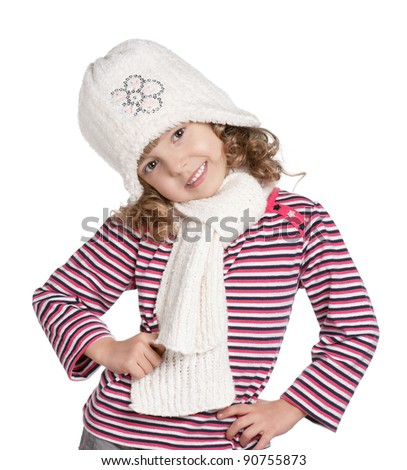 Portrait of a little girl in warm cap and scarf posing on white background - stock photo