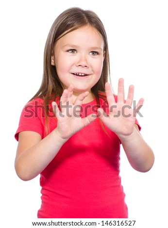 Portrait of a little girl making stop gesture using both hands, isolated over white - stock photo