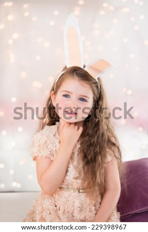 Portrait of a little girl on Christmas or Eastern with bunny ears.  - stock photo