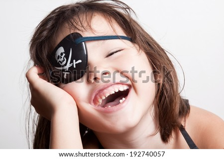 Portrait of a little girl pirate - stock photo