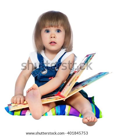 portrait of a little girl reading a book - stock photo