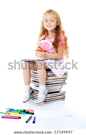 Portrait of a little girl sitting on a stack of books. Over white background. - stock photo