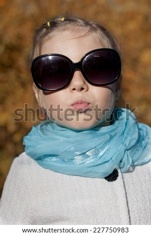 Portrait of a little girl sunny autumn day in the park - stock photo