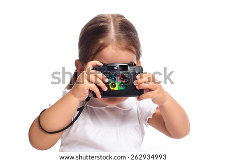 Portrait of a little girl taking a photograph - stock photo