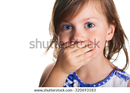 Portrait of a little girl who covered her mouth with hand, isolated on white background - stock photo