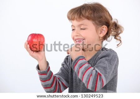 portrait of a little girl with an apple - stock photo