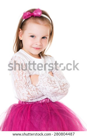 Portrait of a little girl with folded hands over white background - stock photo