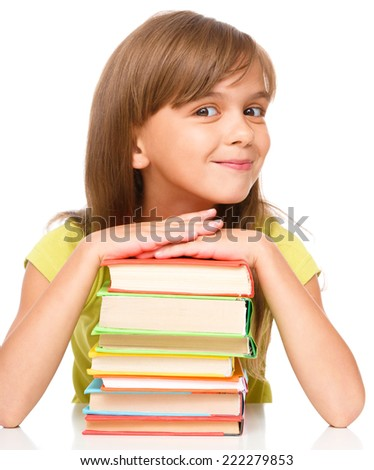 Portrait of a little girl with her books, isolated over white - stock photo