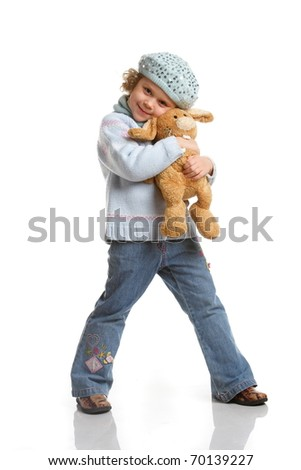 portrait of a little girl with soft toys on a white background - stock photo