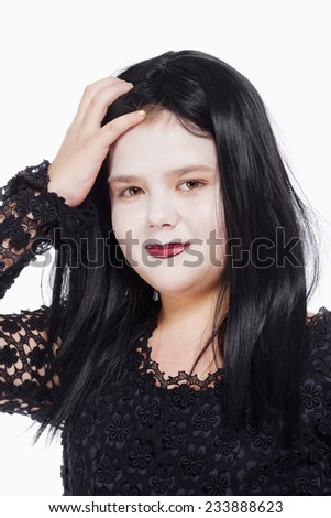 Portrait of a Little Girl with Wig and Scary Makeup - stock photo