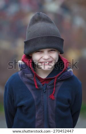 portrait of a little happy homeless boy - stock photo
