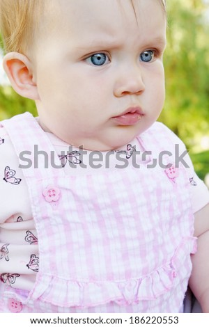 Portrait of a little hurt girl outdoors - stock photo