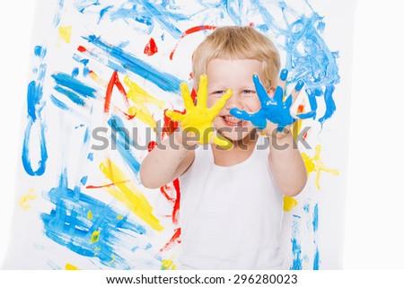 Portrait of a little messy kid painter. School. Preschool. Education. Creativity. Studio portrait over white background - stock photo