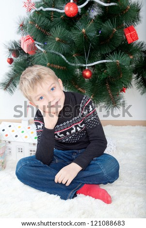 Portrait of a littleboy at christmas - stock photo