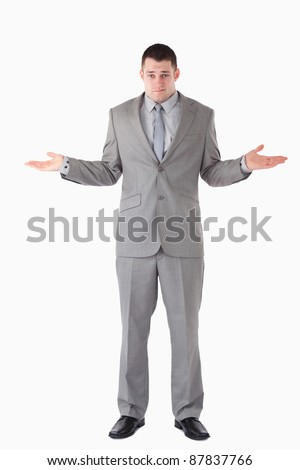 Portrait of a lost businessman against a white background - stock photo