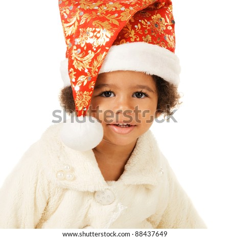 Portrait of a lovely baby in Christmas hat and fur on white background - stock photo