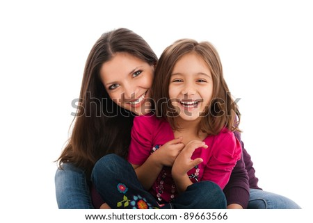 portrait of a lovely little girl with her elder sister, smiling, isolated on white background - stock photo