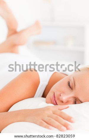 Portrait of a lovely woman sleeping in her bedroom - stock photo