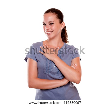 Portrait of a lovely young woman smiling and looking at you on blue blouse standing over white background - stock photo