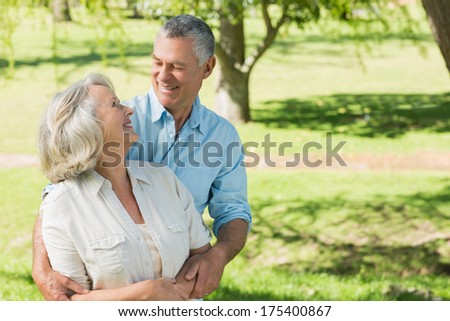 Portrait of a loving and happy mature couple at a summer park - stock photo