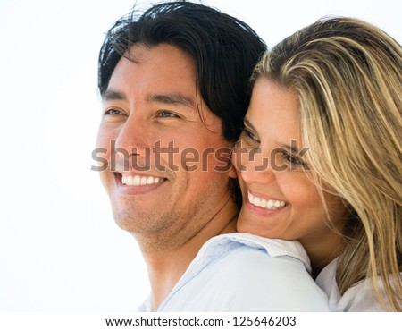Portrait of a loving couple smiling outdoors - stock photo