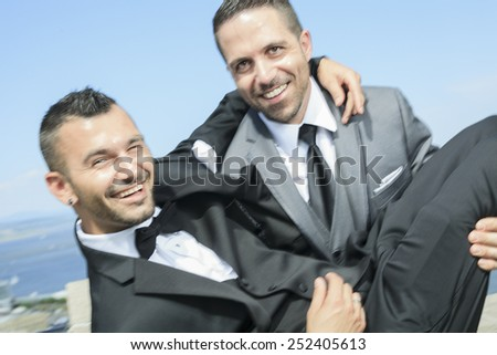 Portrait of a loving gay male couple on their wedding day. - stock photo