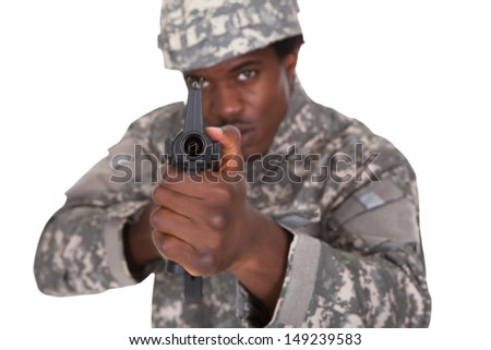 Portrait Of A Male African Soldier Aiming With Gun Isolated Over White Background - stock photo