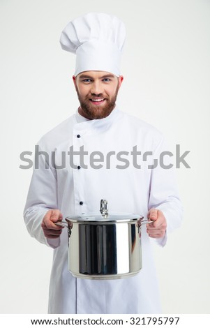 Portrait of a male chef cook holding pan isolated on a white background - stock photo