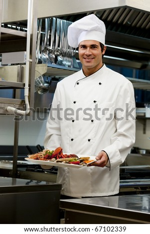 Portrait of a male chef in the restaurant - stock photo