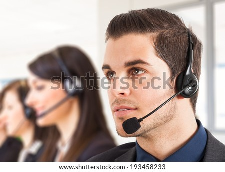Portrait of a male customer representative - stock photo
