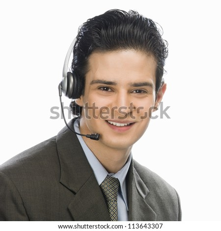 Portrait of a male customer service representative smiling - stock photo