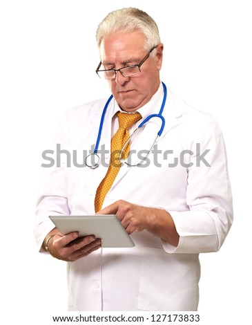 Portrait Of A Male Doctor Holding A Tab On White Background - stock photo