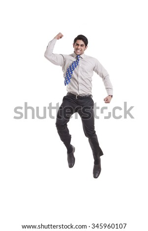 Portrait of a male executive jumping in the air - stock photo