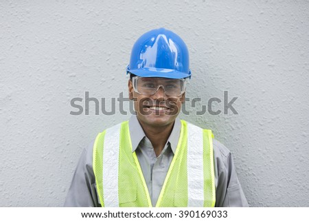Portrait of a male Indian industrial engineer or builder at work. - stock photo