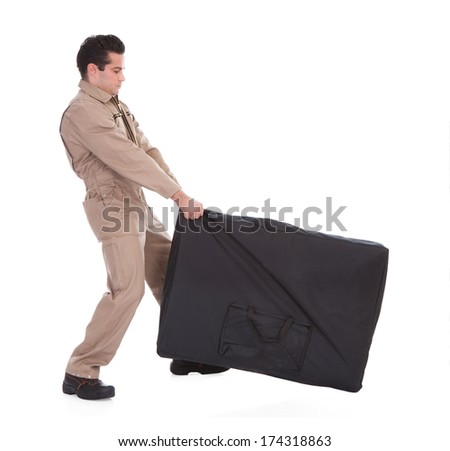 Portrait Of A Male Worker Pulling Luggage Over White Background - stock photo