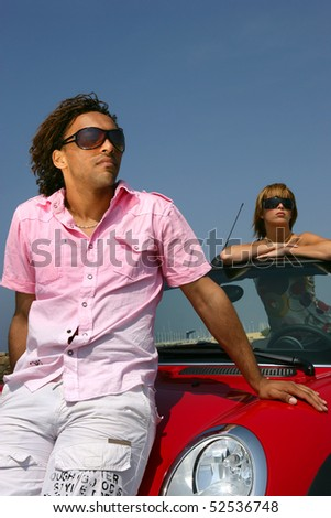 Portrait of a man and a woman in a car - stock photo