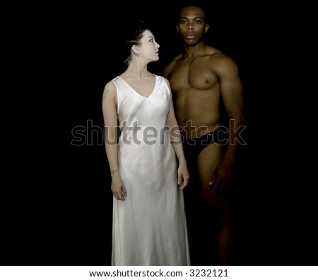 Portrait of a man and a woman, scantly clad. - stock photo