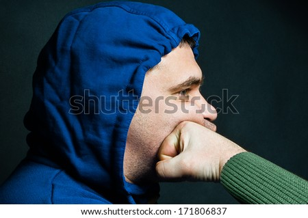 Portrait of a man being shocked in the face in a fist fight - stock photo