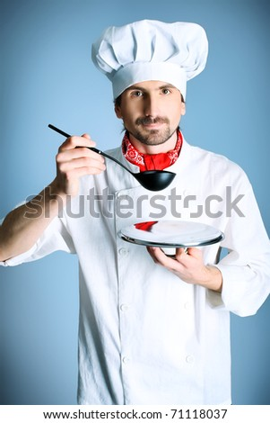 Portrait of a man cook holding a plate and ladle. Shot in a studio over grey background. - stock photo