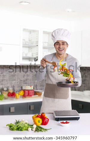 Portrait of a man cooking - stock photo