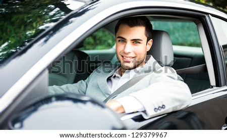 Portrait of a man driving a car - stock photo