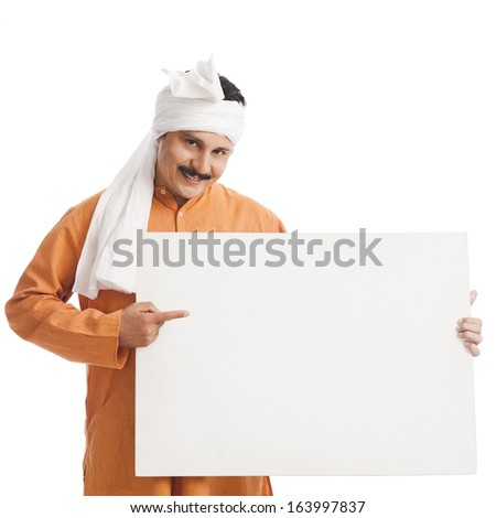 Portrait of a man holding a placard - stock photo