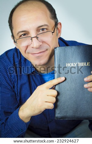 Portrait of a Man Holding Holy Bible - stock photo