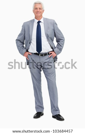 Portrait of a man in a suit with hands on hips against white background - stock photo